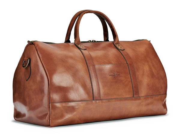 saddle tan full grain vegetable tanned leather duffel bag at angle