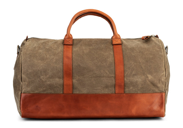 jackson wayne leather weekender front pictured in saddle tan with tan waxed canvas