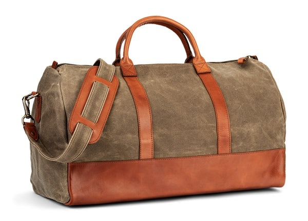 waxed canvas twill leather weekender bag in saddle tan (angle)