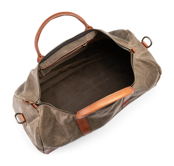 inside of jackson wayne leather weekender bag in saddle tan