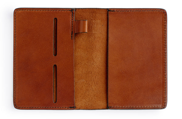 Full grain leather passport cover journal in saddle tan with pen holder