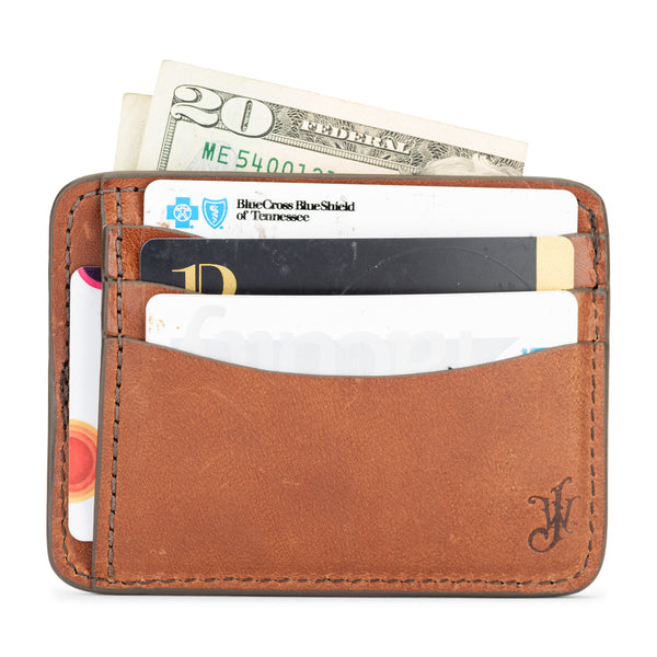 thin full grain vegetable tanned leather wallet by jackson wayne in saddle tan color