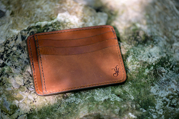 jackson wayne slim wallet full grain vegetable tanned bridle leather in saddle tan color on rocks