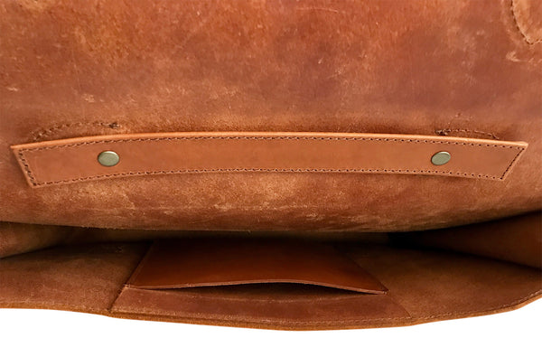 interior pocket of saddle tan leather attache