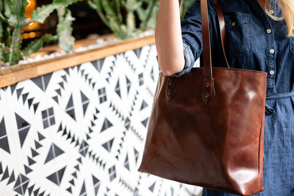 full grain leather tote bag with canvas lining and zipper pocket