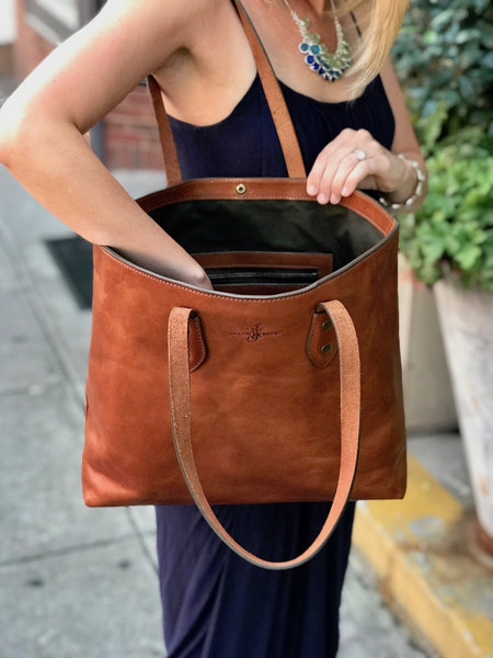 inside franklin market tote bag in saddle tan full grain leather with pine green canvas lining