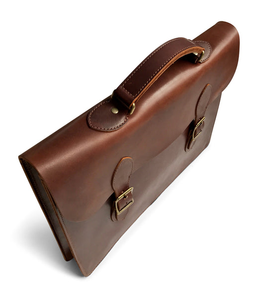 brown genuine leather attache standing up
