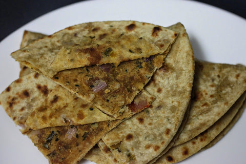 Sattu stuffed achari paratha with garlic curd
