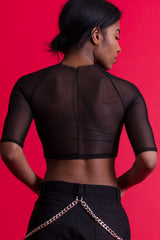 Back view of Sound and Color Mesh Crop Top by Rearrange Us