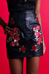 Close up of Colored Emotions Leather Pencil Skirt by Rearrange Us. Made with 100% leather and hand embroidered roses.