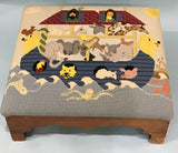 "An Antique Maple Ottoman / Footstool, Needlepoint top ""Noah's Ark"""