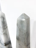 20th Century Pair of Mottled Gray & White Marble Tall Obelisks Top Wear