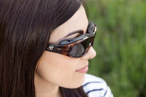 Woman wearing insulated sunglasses