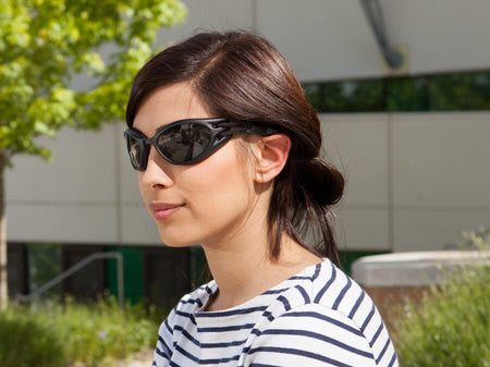 Girl wearing flexible goggles with tinted lenses