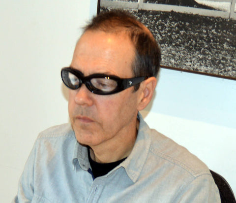 John wearing his Chubasco glasses for computer use