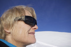 polarised grey lenses cut glare reflected from the ski slope
