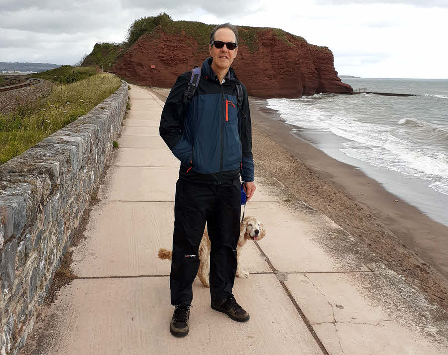 Wearing windproof sunglasses on a seaside walk