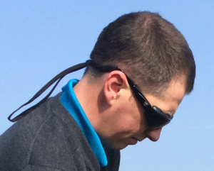 Close up of customer wearing his 7eye Cape for golf