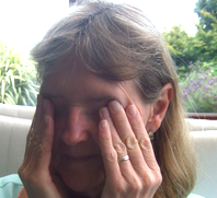woman suffering from allergic conjunctivitis rubbing her eyes