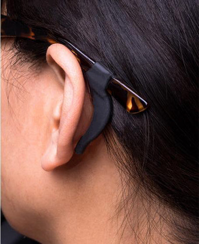woman wearing black silicone temple tips on her glasses