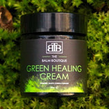 The Green Healing Cream by The Balm Boutique on a natural leafy background