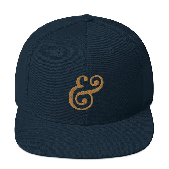 OFFICIAL STONE & SKILLET MUFFINEER AMPERSAND SNAPBACK (NAVY/OLD GOLD)