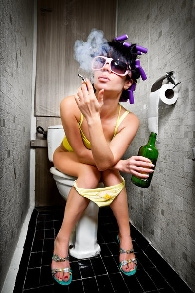 woman smoking on toilet