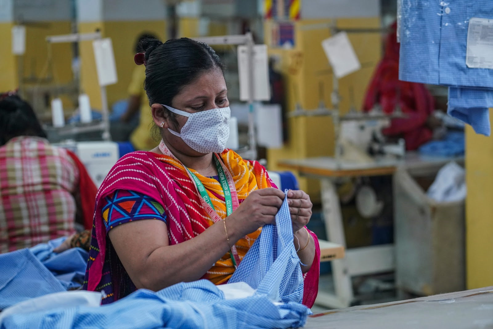 Sewing technician at work in a Dhaka factory during COVID-19.