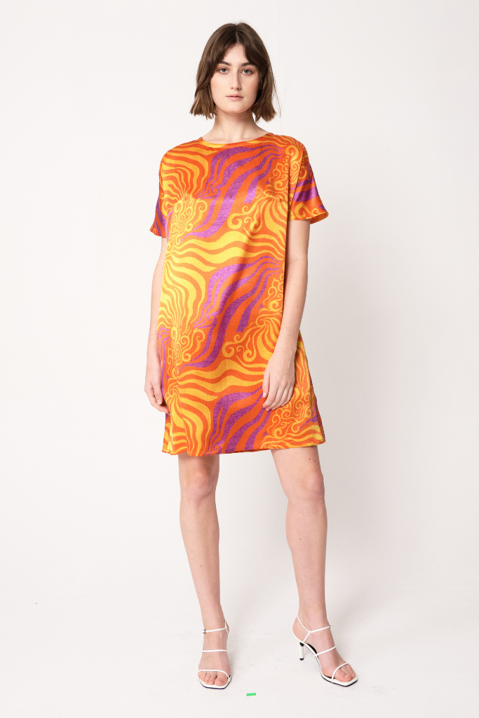 woman wearing orange and purple silk printed dolman dress with short sleeves