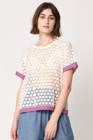 woman wearing white circular lace with purple pink checkerboard elastic accents