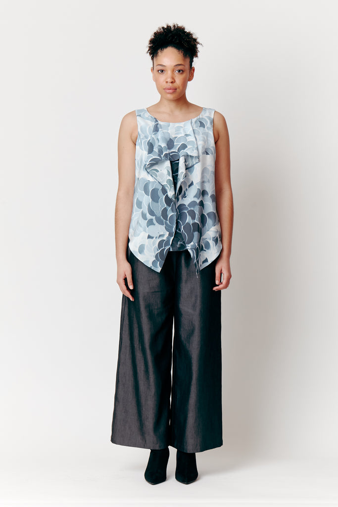 Maia wears a Bianca Spender Blue Wave Top with Ebony Relaxed Pants.