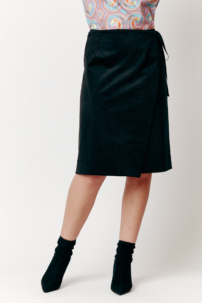 Maia wears our Black Cord Wrap Midi Skirt with our Gary Bigeni Shell Top.