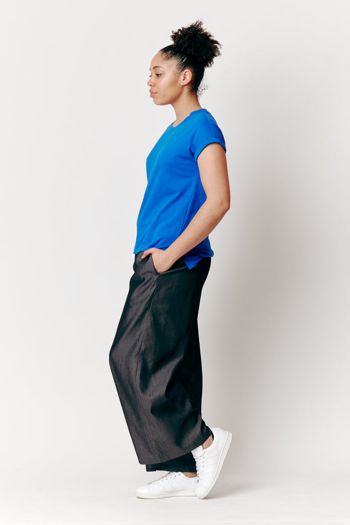Maia Wears our Ebony Relaxed Pants with our Dorsu x The Social Outfit Cobalt Rolled Sleeve T-shirt