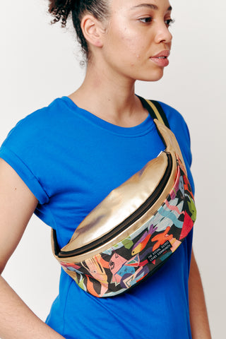 Maia wears our Fairfield Funky Bum Bag slung over our Dorsu x The Social Outfit Cobalt Rolled Sleeve Top