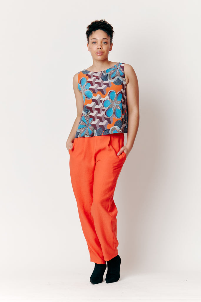 Maia wears our Gunjan Aylawadi Remix Shell Top with our Tangerine Tapered Pants