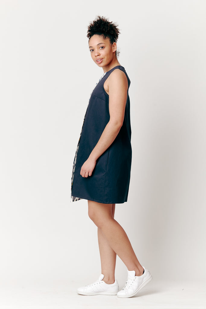 Maia wears our Navy woods Overlap Tunic Dress