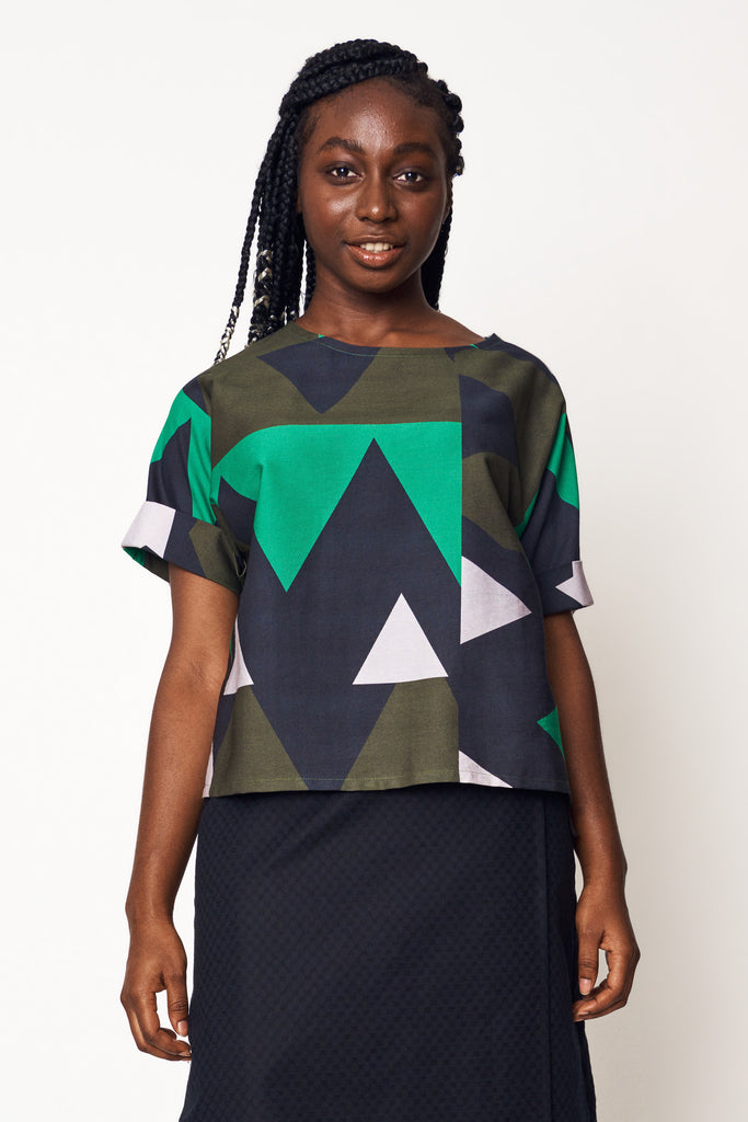 henrietta wears our abstract forest scoop top with noir weave wrap skirt for aw21 earth to sky