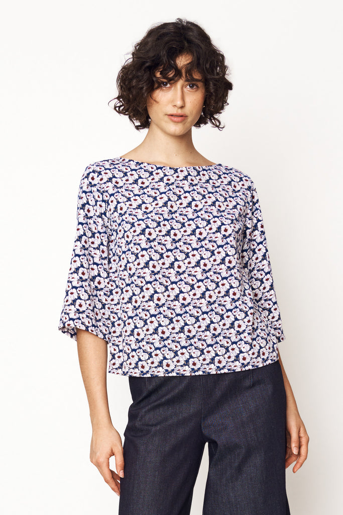 mia wears our flower mosaic smock top with our dark indigo denim culottes for aw21 earth to sky
