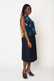 henrietta wears our navy canary contrast shell top with our noir weave wrap skirt