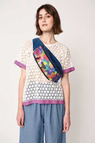 woman wearing blue and pink organic cotton canvas spliced velvet bum bag in fun print