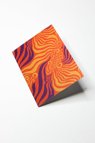 orange and purple printed greeting card on top of white background