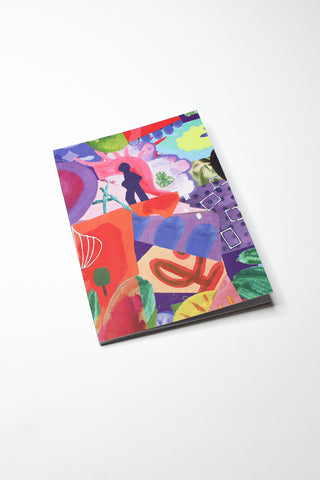 multi-coloured printed notebook sitting on white background