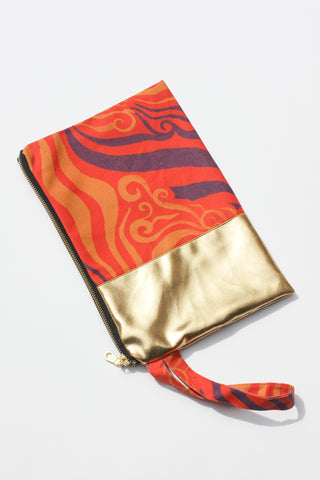 orange and purple printed organic canvas clutch spliced with remnant gold fabric and strap