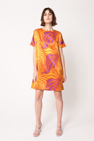 woman wearing orange and purple silk printed thigh-length dolman dress
