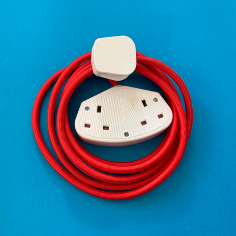 Neon Red extension lead with white socket and plug