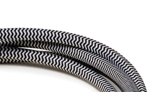Black and white zigzag extension lead with black socket and plug