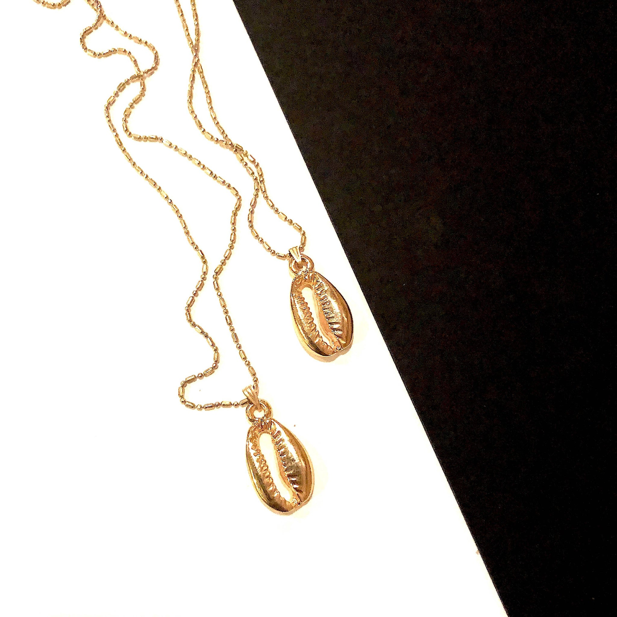 Gold Cowrie Necklace by Boho Gal Jewelry