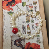 19BR-IS-RR Swarovski Pearl Stretch Bracelet with One Flower Essence Bead ~ In Stock Item