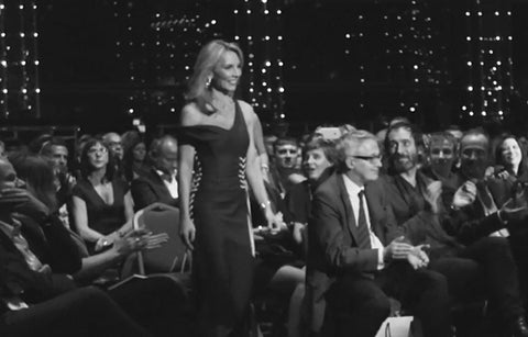Nicole Mather in a black and white picture walking to receive an award.