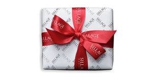 Gift box wrapped with House of Sillage decoration
